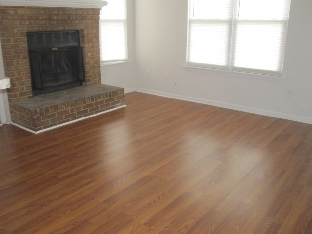 Virginia beach wood laminate flooring daw and son for Wood floor up to fireplace
